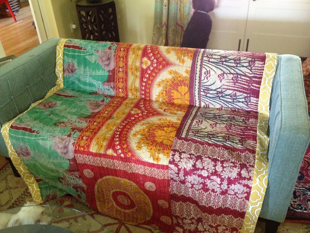 indian fabric quilt with gold fabric strip added to sides