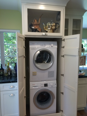 washer/dryer and display cabinet