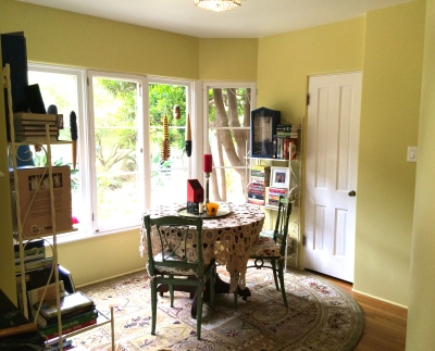 standing between kitchen and sunroom
